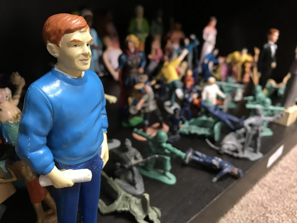 Toy man surrounded by figurines for play therapy near Tampa, FL. You can meet with a play therapist at Sheltering Oaks Counseling for play therapy in Wesley Chapel, FL via online therapy in Florida too!