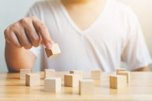 Person sorting blocks. You can get testing and evaluation for autism near Tampa, FL