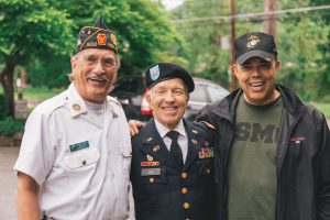 Veterans smiling and holding each others backs in uniform. Mental health disability evaluation in Tampa, FL and Wesley Chapel, FL for veterans are available at Sheltering Oaks Counseling FL