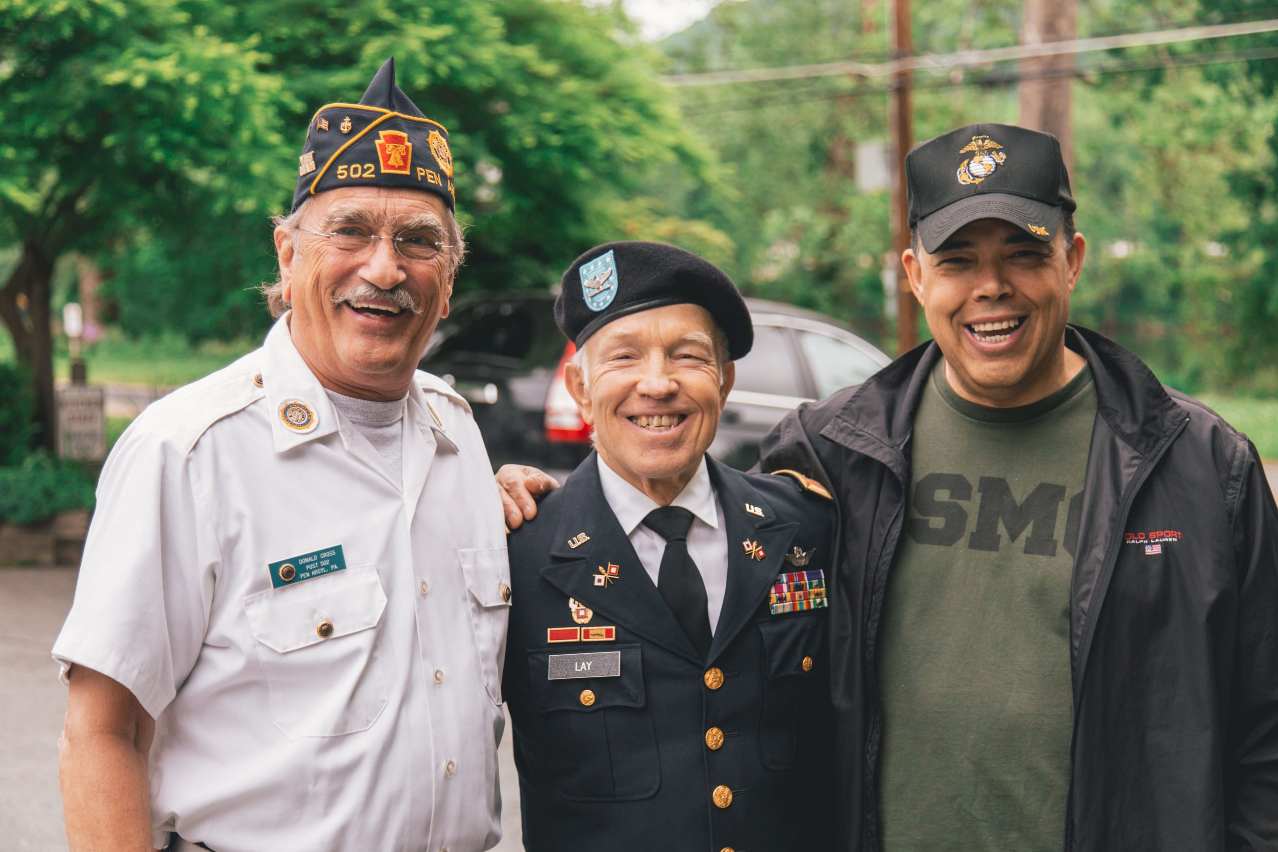 Group of veterans embracing and smiling for the camera in uniform and military attire. You too can meet with a therapist providing counseling for veterans in Wesley Chapel, FL. We also provide mental health disability evaluation for VA benefits. You can get therapy for veterans near Tampa, FL at Sheltering Oaks Counseling in Wesley Chapel, FL