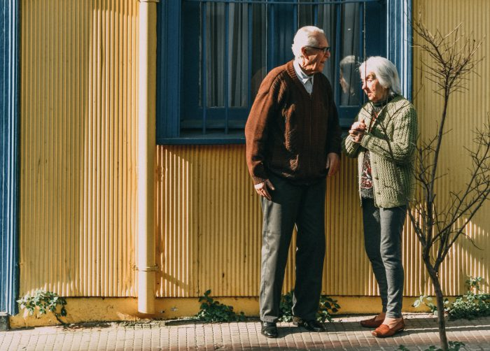 Elderly Couple standing outside of a window talking to each other. Can get help with neuropsychological testing in Tampa, FL at Sheltering Oaks Counseling in Wesley chapel, FL or in online therapy in Florida