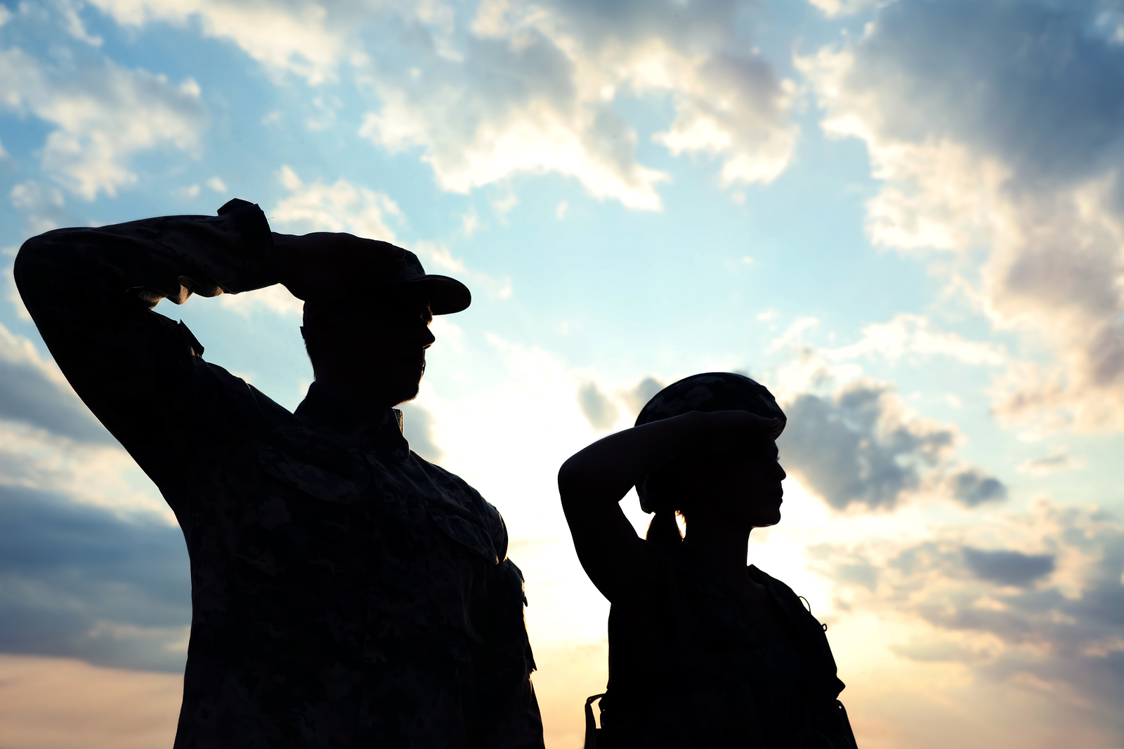 Soldiers in uniform saluting outdoors in the clouds. You can find a therapist providing counseling for veterans in Wesley Chapel, FL. She also provides mental health disability evaluation for VA benefits. You can get therapy for veterans near Tampa, FL at Sheltering Oaks Counseling in Wesley Chapel, FL