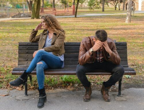Man and woman sitting on a bench looking upset needing couples therapy.  You can feel better after family therapy in Wesley chapel, fl. Online therapy in Florida can help with family counseling and couples therapy near Tampa, FL.