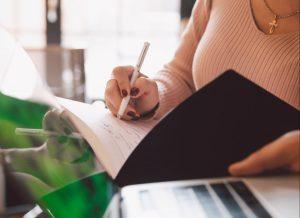 woman writing || Sheltering Oaks Counseling || Wesley Chapel, FL